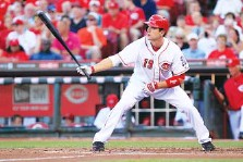 ?? AP PHOTO/AL BEHRMAN ?? Saturday's Chattanooga Lookouts game includes a bobblehead giveaway of the Cincinnati Reds' Joey Votto.