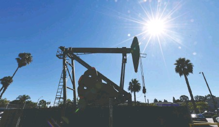 ?? FREDERIC J. BROWN/AFP VIA GETTY IMAGES FILES ?? When we get through the coronavirus, the world will still need in the neighbourhood of 100 million barrels of oil each day to keep the lights on, says Tom Bradley. He believes the next oil boom could turn out to be as good as this bust is bad.