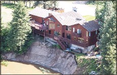 ??  ?? A house sitting on a slope damaged by floodwaters is seen in Grand Forks, Brtish Columbia on May 12. Thousands of people have been evacuated from their homes in British Columbia's southern interior as officials warn of flooding due to extremely heavy...