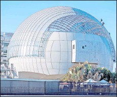 ?? — AFP file photo ?? Workers clean the roof of the new Academy Museum of Motion Pictures, amid the coronavirus pandemic, in Los Angeles, california.