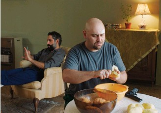 """??  ?? Rodrigue Sleiman, left, and Raed Yassin in a scene from Wissam Charaf's feature film debut """"Tombé du ciel""""(Heaven Sent)."""