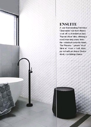 ??  ?? A luxe freestanding Formoso 'Clearwater' tub from Reece is set offff by Artedomus Inax 'Repeat Wave' tiles, offffering a cool, fresh step away from the industrial concrete tones. The Phoenix Tapware ' Vivid Slimline' mixer in matt black, paired with an Anaca Studio stool, is a striking choice. ENSUITE