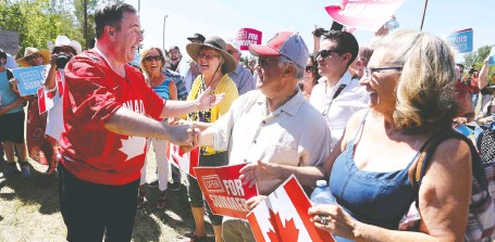"""?? JIM WELLS ?? Alberta Premier Jason Kenney arrives for a Canada Day event in Parkland on Thursday. """"We are open for summer,"""" he declared."""