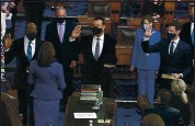 ?? SENATE TELEVISION VIA AP ?? Vice President Kamala Harris swears in Sen. Raphael Warnock, D-Ga., Sen. Alex Padilla, D-Calif., and Sen. Jon Ossoff, D-Ga., on the floor of the Senate on Wednesday.