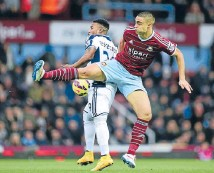 ?? Photo: GETTY IMAGES ?? On the move: Winston Reid, right, making a challenge in a game for West Ham against West Brom last month, is set to move to Tottenham Hotspur in a deal worth $120,000 a week.