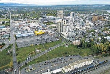 ?? Picture: Education Images/LUIG via Getty Images ?? In 1982, Alaska established the Alaska Permanent Fund — funded through oil revenues — which pays citizens an annual dividend. Anchorage is pictured above.
