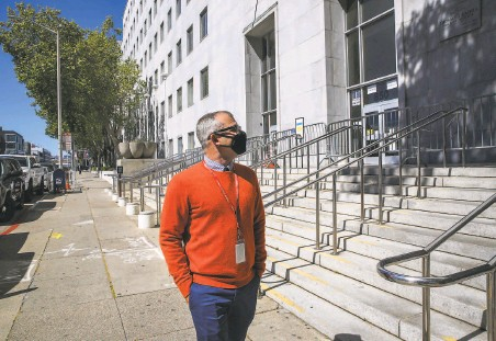 ?? Yalonda M. James / The Chronicle ?? Gary McCoy, director of public affairs at HealthRight 360, walks outside the Hall of Justice, where he had served time in jail. Now in recovery for about 10 years, he's telling the story for the first time of his years of homelessness and drug addiction.
