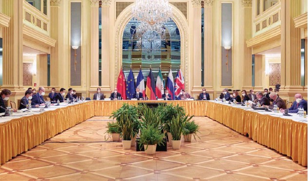 ?? Reuters ?? ↑ Delegates wait for the start of a meeting of the JCPOA Joint Commission in Vienna on Saturday.