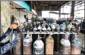 ?? PTI ?? Empty oxygen cylinders being refilled, to be transported to hospitals for Covid-19 patients, amid the rise in Covid-19 cases across the country, in Lucknow, on Thursday