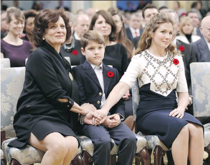 ?? CHRIS WATTIE/AFP/GETTY IMAGES ?? From left, Justin Trudeau's mother Margaret, son Xavier and wife Sophie Gregoire hold hands before Trudeau is sworn-in as Canada's 23rd prime minister during a ceremony at Rideau Hall on Wednesday.