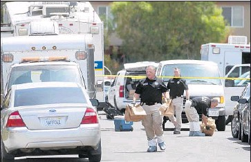 ?? JohnWestberg Associated Press ?? POLICE OFFICERS carry bags of evidence from aModesto home where five bodies were found Saturday. Martin Martinez was arrested Sunday in San Jose on suspicion of killing two women and three children.