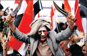 ?? PICTURE: REUTERS ?? A man waves traditional daggers, or Jambiyas, as he attends with supporters of the Houthi movement and Yemen's former president Ali Abdullah Saleh a rally to mark two years of the military intervention by the Saudi-led coalition, in Sanaa, Yemen...