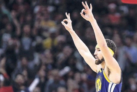 508cf693bfa Golden State Warriors guard Klay Thompson celebrates after scoring a three  pointer against the Chicago Bulls during the second half of an NBA  basketball ...