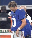 ?? LARRY W. SMITH, EPA ?? Eli Manning was the picture of dejection after the Cowboys' late drive led to a 27-26 victory against the Giants on Sunday night.