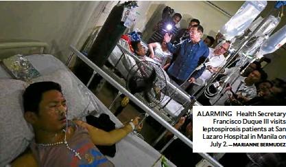 ?? —MARIANNE BERMUDEZ ?? ALARMING Health Secretary Francisco Duque III visits leptospirosis patients at San Lazaro Hospital in Manila on July 2.