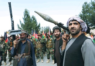 ?? (Reuters) ?? ARMED MEN attend a gathering last week on the outskirts of Kabul to announce their support for Afghan security forces and that they are ready to fight against the Taliban.