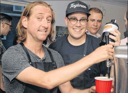 ?? JOE GIBBONS/THE TELEGRAM ?? Dan Meades (left) and Kris Smith of Third Place Cocktail Co., launched their new Radler beer enhancer during a special event Friday evening at Olio Pizza on Harvey Road in St. John's
