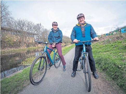 ??  ?? BIKE IT: Scottish Lib Dem leader Willie Rennie and national leader Sir Ed Davey on the campaign trail in Edinburgh.