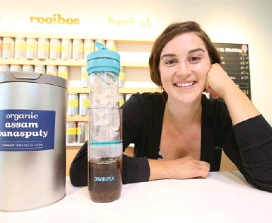 ?? VINCE TALOTTA/TORONTO STAR ?? Logan Klassen, manager of DavidsTea's flagship store on Queen St. W., is moving to Miami to open the chain's first Florida location. DavidsTea has 165 outlets in Canada and 47 in the U.S., and is set to open 39 new stores in North America this year.