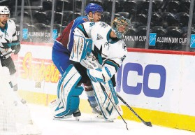 ?? David Zalubowski / Associated Press ?? Sharks goaltender Josef Korenar, who made 40 saves, clears the puck as Avalanche right wing Mikko Rantanen trails the play in the second period.