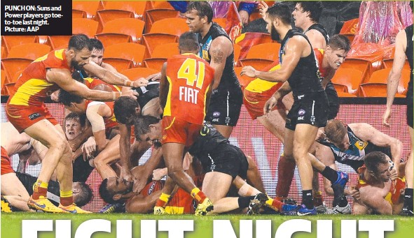 ??  ?? PUNCH ON: Suns and Power players go toeto-toe last night. Picture: AAP