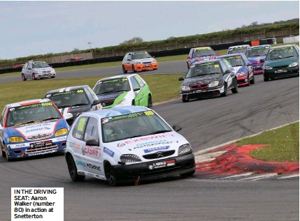 ??  ?? IN THE DRIVING SEAT: Aaron Walker (number 80) in action at Snetterton