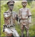 ?? BRUCE EDWARDS, THE JOURNAL ?? Danek Mozdzenski's memorial to fallen police officer Ezio Faraone