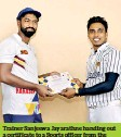 ??  ?? Trainer Sanjeewa Jayarathne handing out a certificate to a Sports officer from the Laggala area.