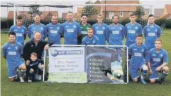 ??  ?? Andy Phillips, front centre, presents Cayton Corinthians with their new kit, sponsored by AP Kit Store