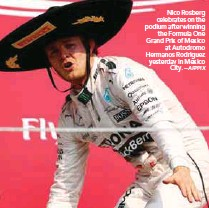 ?? AFPPIX ?? Nico Rosberg celebrates on the podium after winning the Formula One Grand Prix of Mexico at Autodromo Hermanos Rodriguez yesterday in Mexico City. –