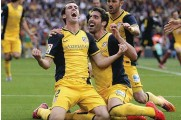 ??  ?? CHAMPION: Diego Godin celebrates after his powerful header won Atletico Madrid the vital point