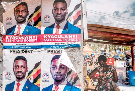 "?? PHOTOS BY SUMY SADURNI/AGENCE FRANCE-PRESSE/GETTY IMAGES ?? Posters of singer-turned-politician Bobi Wine are seen in Kampala, Uganda, on Jan. 4. Wine is running against President Yoweri Museveni, who is seeking a sixth term. Wine has repeatedly called Museveni a ""dictator"" during his campaign rallies."