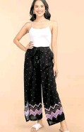 ??  ?? Kultura's printed palazzo pants worn with a white tank top is perfect for lounging at home and running errands.