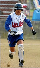 ?? GETTY IMAGES ?? Christchurch United's Rhonda Hira strides out for first base at a national women's interclub final in Wellington.