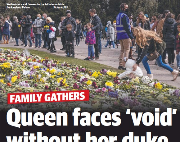 ??  ?? Well-wishers add flowers to the tributes outside Buckingham Palace. Picture: AFP