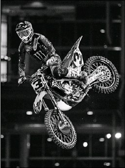 ?? Ashley Landis/Staff Photographer ?? Eli Tomac gets some air on his way to the victory in the 450SX Main Event at Monster Energy AMA Supercross at AT&T Stadium.