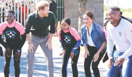 ?? CHRIS JACKSON/GETTY IMAGES ?? Prince Harry, second from left, seen with his wife Meghan, second from right, at a Waves for Change event to raise awareness for the children's mental health organization, has recently said that he has been in therapy for seven years.