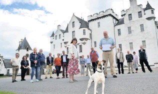 ??  ?? Warm welcome Sarah Troughton, head trustee of Blair Castle and Tony Dowson, coordinator, Blair Atholl and District Resilience Group with volunteers on Wednesday, the day the castle grounds reopened on Wednesday 150720BlairCastleCheque_01