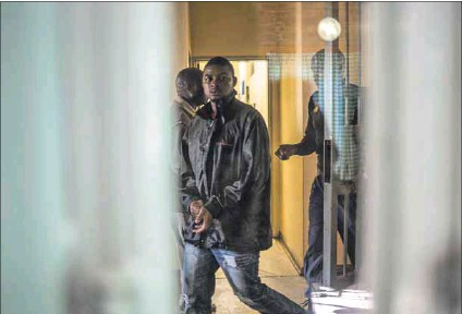 ?? Photo: Stefan Heunis/afp ?? Courting trouble: An accused poacher walks from the holding cells to the court room to attend his hearing at the courthouse in Skukuza in June, 2015, well before it was shut for more than a year.