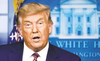 ?? SUSANWALSH/AP ?? During a White House announcement on drug pricing Friday, President Donald Trump again claimed that he won the election.
