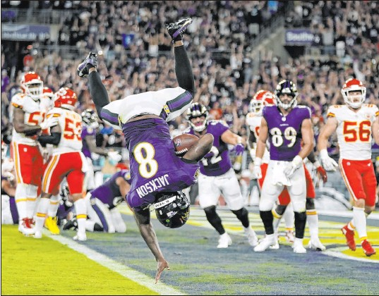 ?? Julio Cortez The Associated Press ?? Baltimore Ravens quarterback Lamar Jackson scores a touchdown during the fourth quarter against the Kansas City Chiefs.
