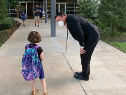 ?? Photos courtesy of Shelby Akin, PGISD public relations manager ?? right: PGISD Superintendent Chad Pirtle welcomes a student at Pleasant Grove Elementary.