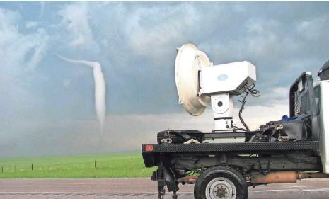 ?? ROBIN TANAMACHI ?? A University of Massachusetts radar truck observes a Wyoming tornado June 5, 2009, during the VORTEX-2 campaign.