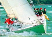??  ?? Prince Philip skippering his yacht Yeoman at Cowes in 2006