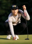 ?? Photo / AP ?? Ly­dia Ko lines up a putt on the 12th hole at Arnon­imink.