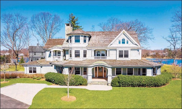 ?? Contributed photos ?? Bright with lots of sunshine, this Darien home on 2.18 acres comprises more than 7,000 square feet of living space.