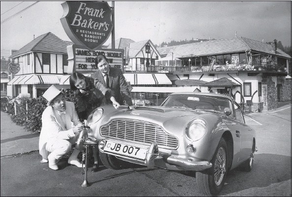 ?? — PNG FILES ?? Restaurateur Frank Baker, left, with the Aston Martin he bought from Mr. and Mrs. Sandy Luscombe-Whyte in 1969.