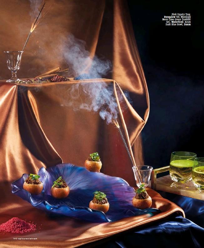 ??  ?? Pink Uqartz Tray, Bungalow 55; Mixology Neon Lime Green Tumbler Set, Waterford; Arum Dark Blue Bowl, Daum