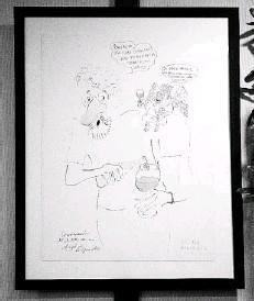 ??  ?? AL LADO del féretro se expusieron varias de sus piezas, aquí una de ellas titulada Conversación del artista con su ángel de la guar da.
