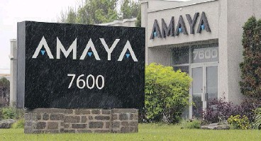 ?? RYAN REMIORZ / THE CANADIAN PRESS FILES ?? Amaya's Pointe- Claire, Que., offices were raided by the RCMP and AMF in 2014.